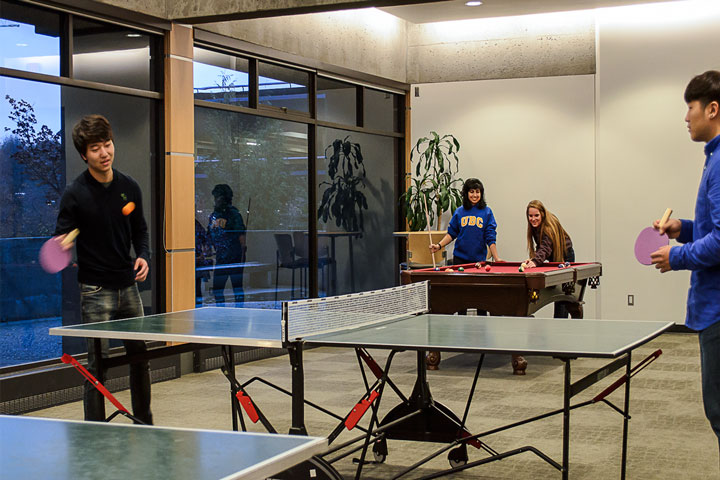 UBC residents unwind in the Walter Gage games room, known as the Fort Camp Lounge.