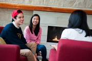 UBC residents gather near the fireplace in the Marine Drive residence Commonsblock.
