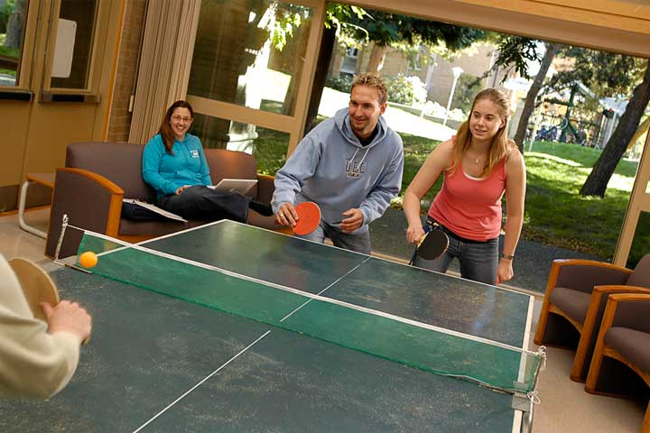 Residents play ping-pong in the Rits-UBC common space.