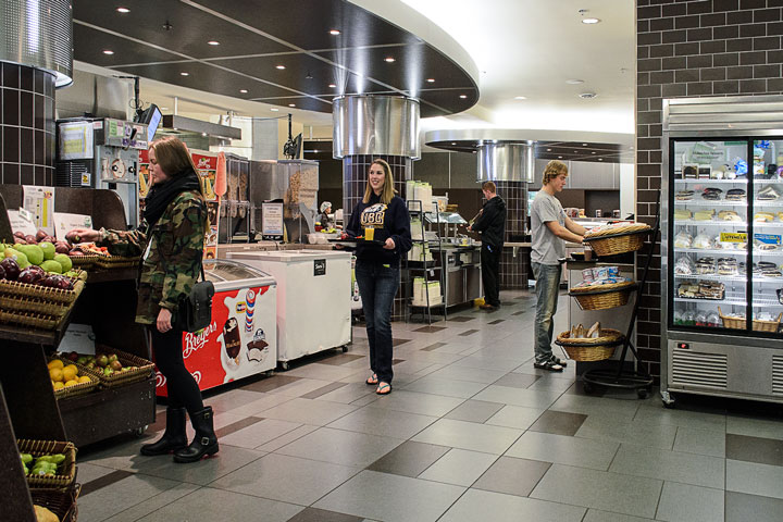 Hungry residents browse menu options at the Totem Park dining hall, UBC.