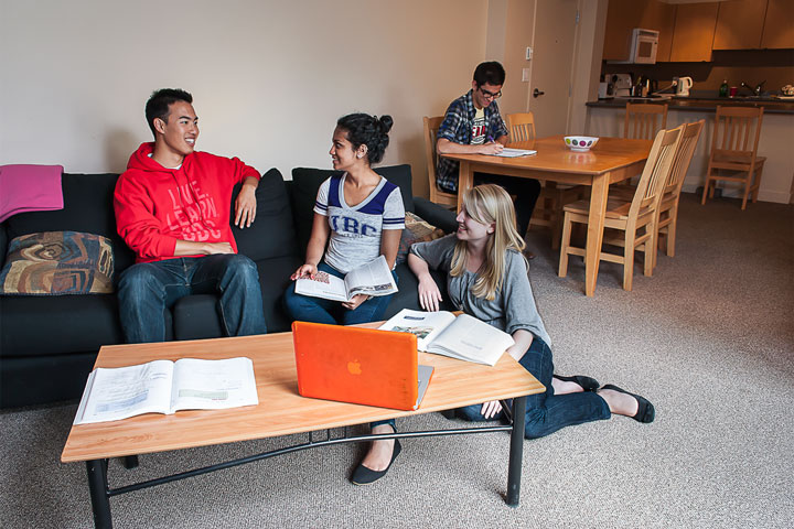 UBC Fraser Hall residents relax and socialize in a living room space.