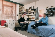 Male roommates study and socialize in a shared room at Totem Park, UBC.