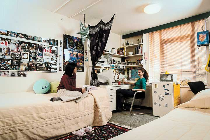 Female residents socialize in a shared traditional room at Totem Park, UBC.