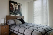Studio suite with double bed at UBC Ponderosa Commons residence.