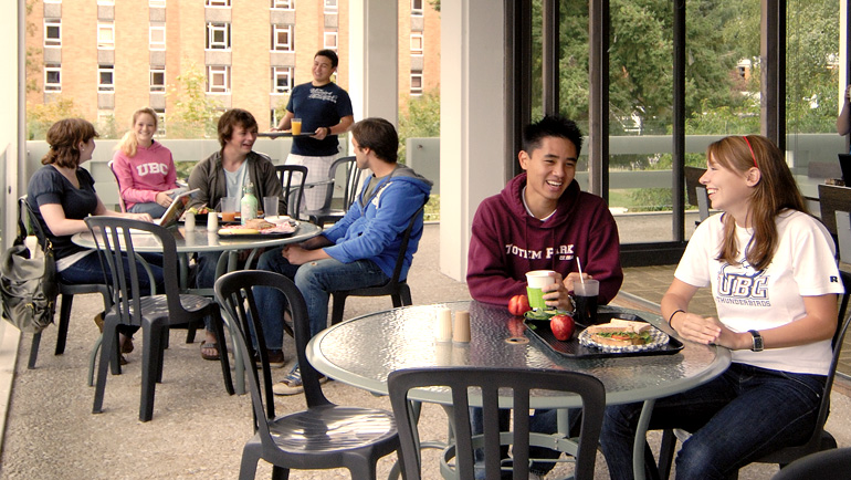 Students dining on a patio.