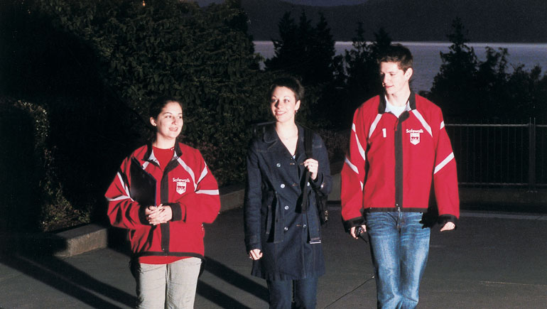Three students walking together.