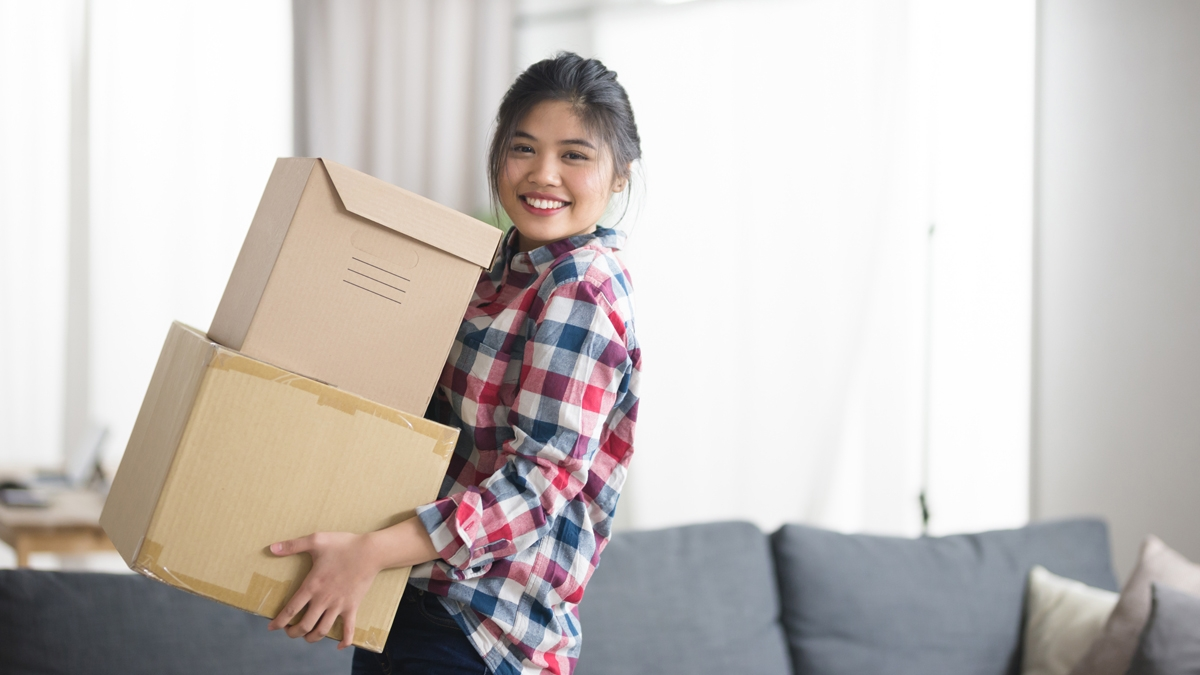 Young woman with moving boxes