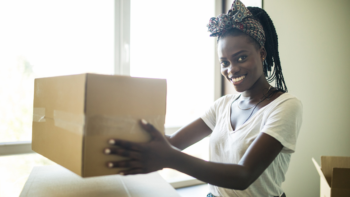 Young woman moving in to UBC residence